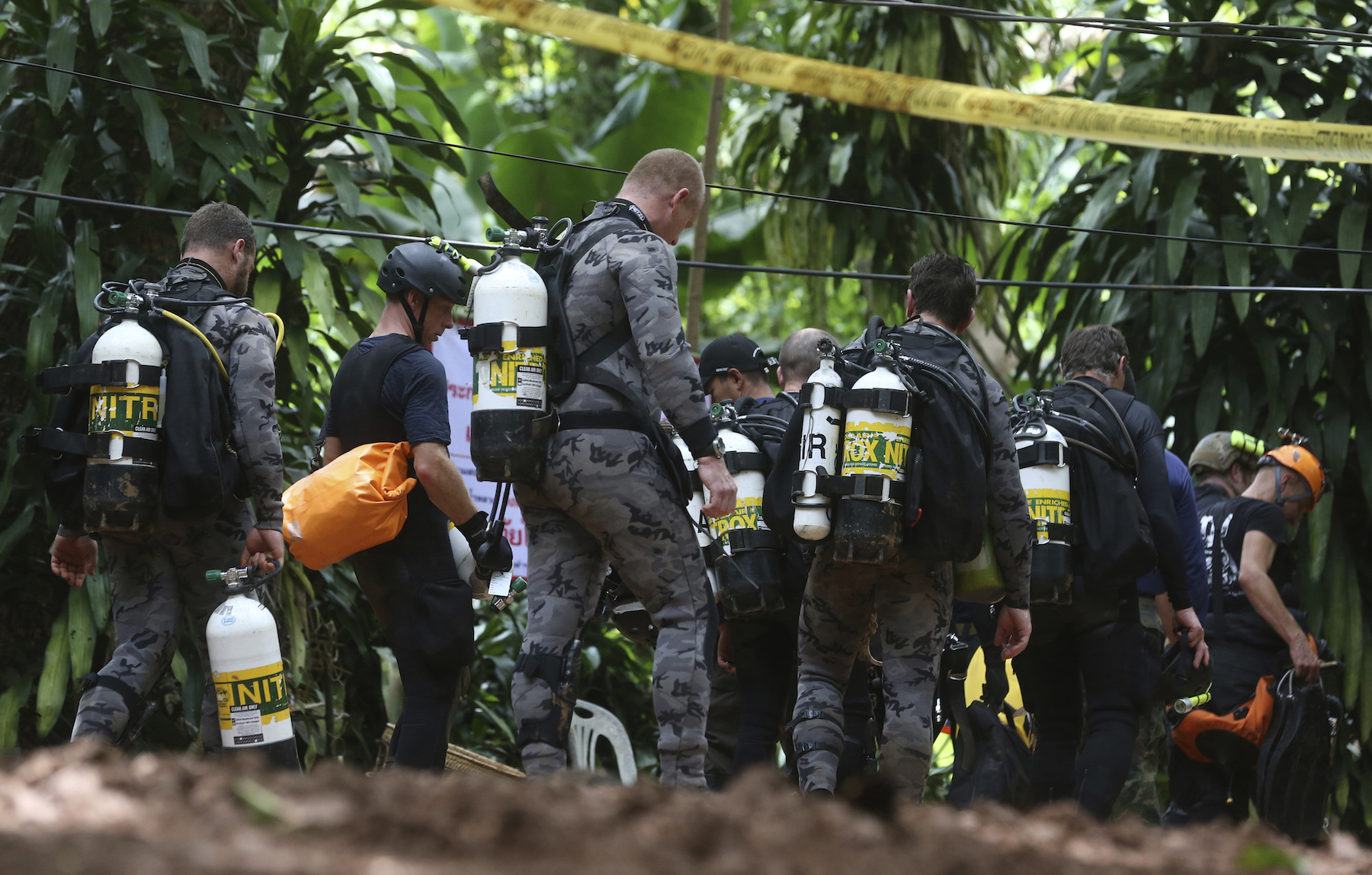 "<div class=""meta image-caption""><div class=""origin-logo origin-image ap""><span>AP</span></div><span class=""caption-text"">International rescuers team prepare walk in of a cave where a young soccer team and their coach are believed to be missing, Thursday, July 5, 2018. (AP Photo/Sakchai Lalit)</span></div>"