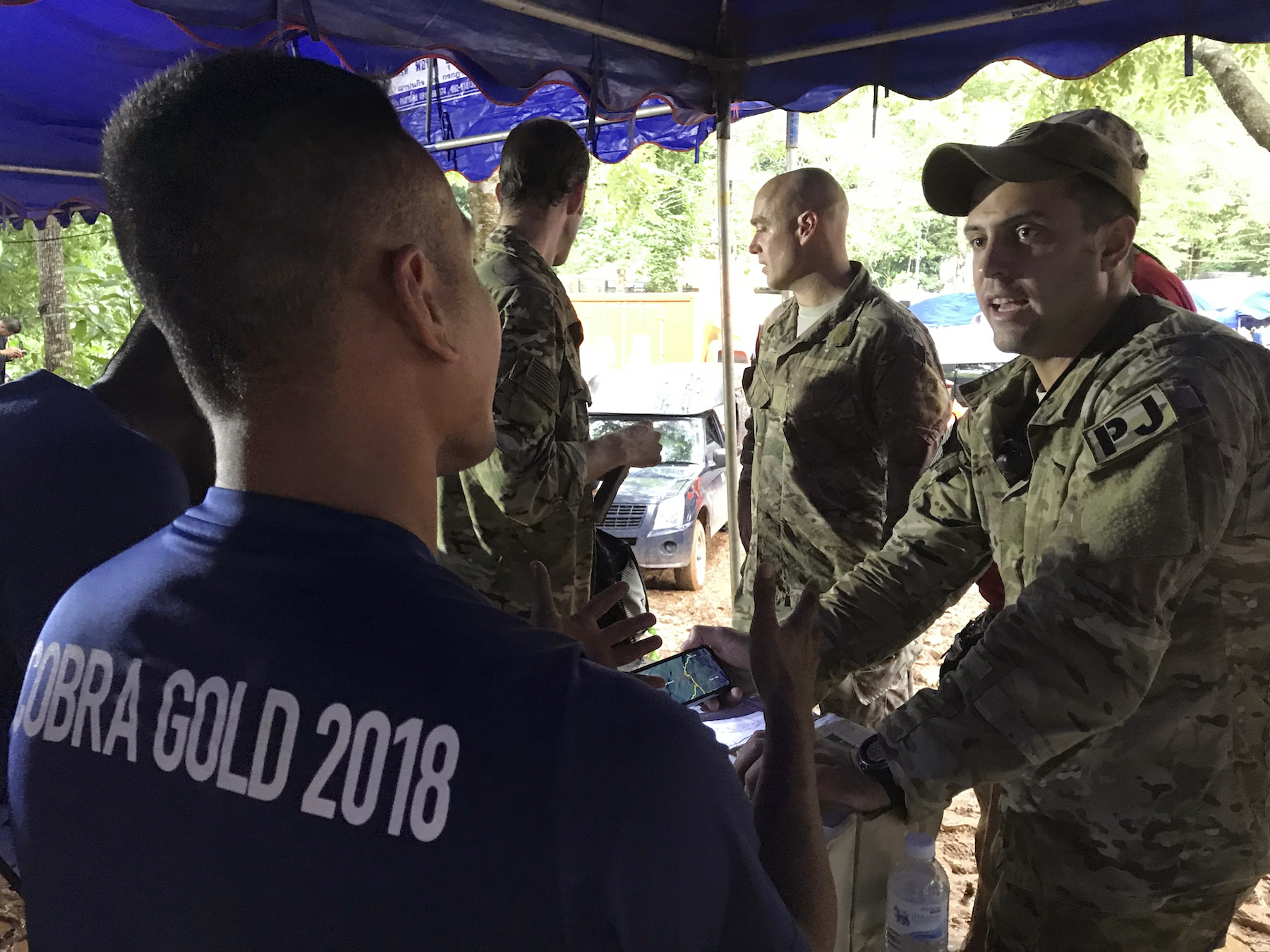"<div class=""meta image-caption""><div class=""origin-logo origin-image ap""><span>AP</span></div><span class=""caption-text"">A U.S. military rescue team is briefed by the Thai Navy SEALs at the staging area outside the Tham Luang Nang Non cave in Mae Sai, Chiang Rai province, northern Thailand . (AP Photo/Tassanee Vejpongsa)</span></div>"