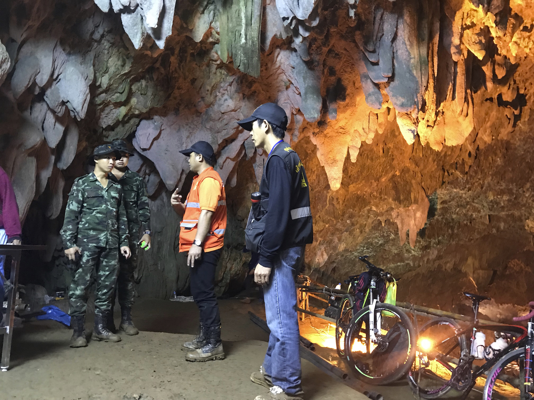 "<div class=""meta image-caption""><div class=""origin-logo origin-image ap""><span>AP</span></div><span class=""caption-text"">Members of the emergency rescue team talk in the staging area as they continue the search for a young soccer team and their coach believed to be missing in a large cave. (AP Photo/Tassanee Vejpongsa)</span></div>"