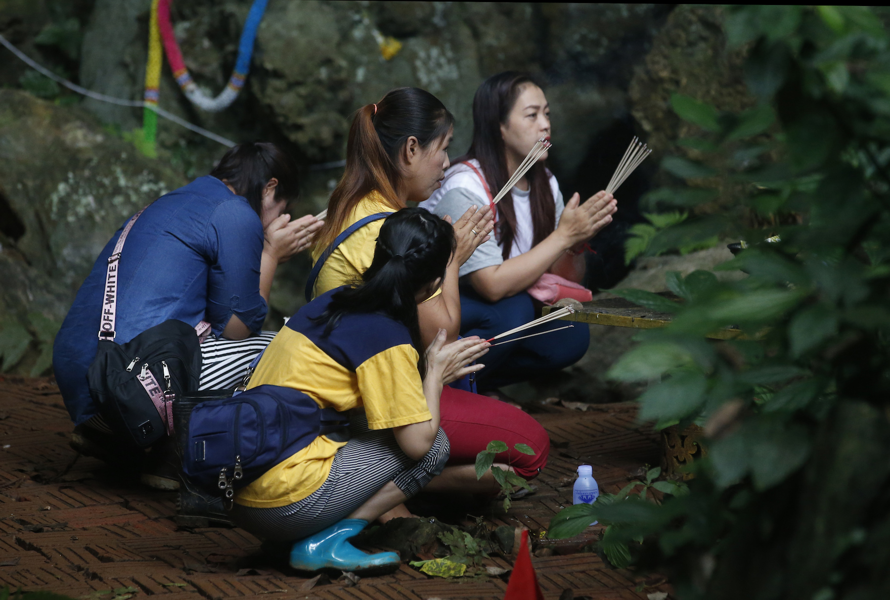 "<div class=""meta image-caption""><div class=""origin-logo origin-image ap""><span>AP</span></div><span class=""caption-text"">Family members pray near a cave where 12 boys and their soccer coach have been trapped since June 23, in Mae Sai, Chiang Rai province, in northern Thailand Saturday, July 7, 2018. (AP Photo/Sakchai Lalit)</span></div>"