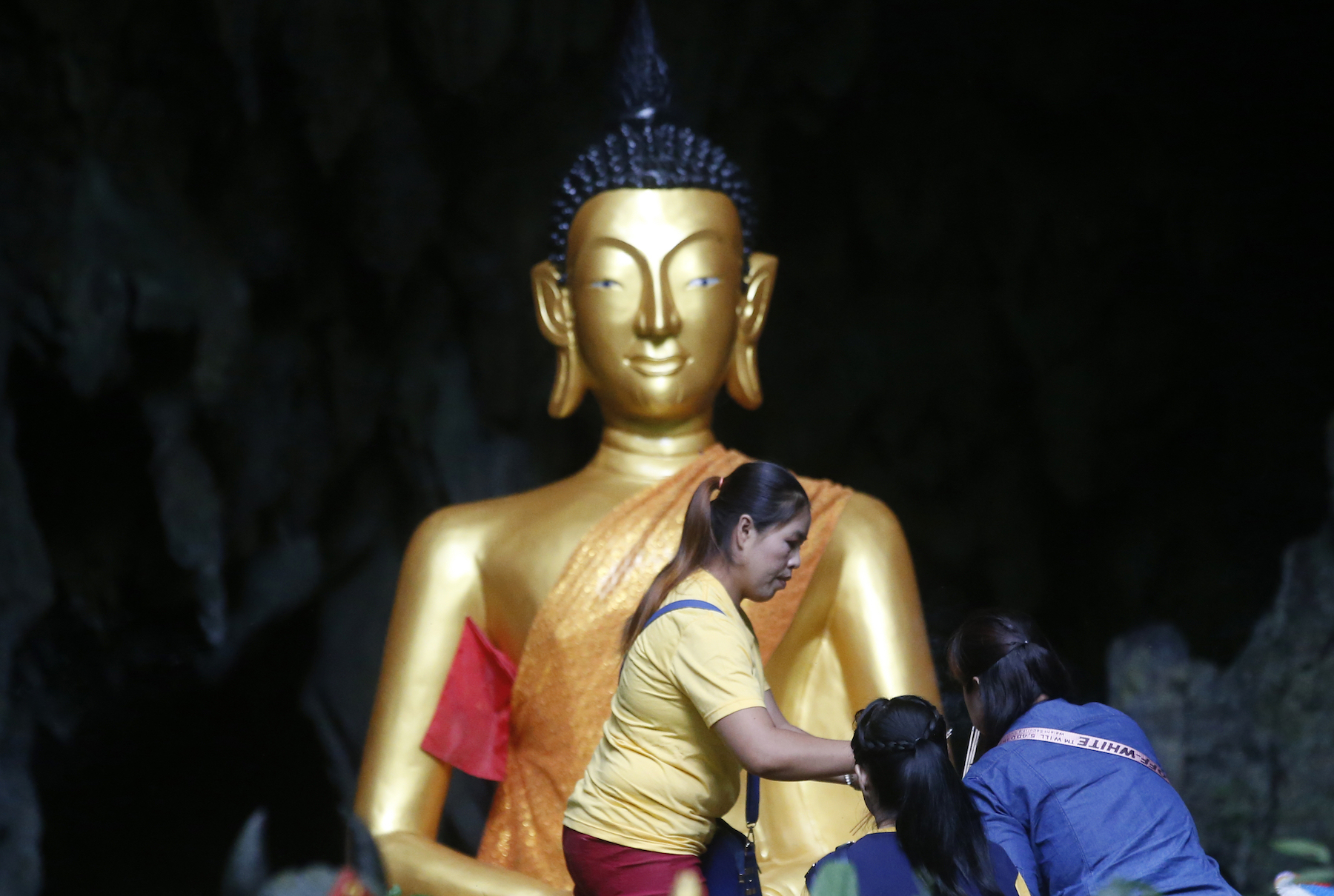 <div class='meta'><div class='origin-logo' data-origin='AP'></div><span class='caption-text' data-credit='AP Photo/Sakchai Lalit'>Family members pray in front of a Buddhist statue near a cave where 12 boys and their soccer coach have been trapped since June 23, in Mae Sai, Chiang Rai province.</span></div>