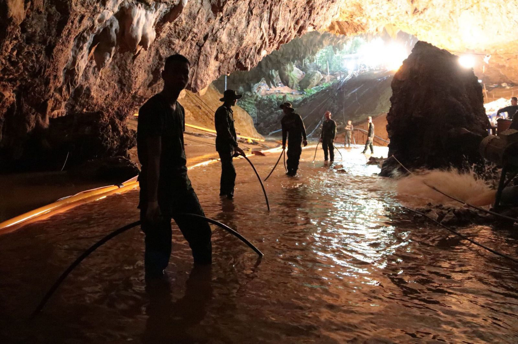 "<div class=""meta image-caption""><div class=""origin-logo origin-image ap""><span>AP</span></div><span class=""caption-text"">Thai rescue teams arrange a water pumping system at the entrance to a flooded cave complex where 12 boys and their soccer coach went missing in northern Thailand. (Thai Navy via AP)</span></div>"