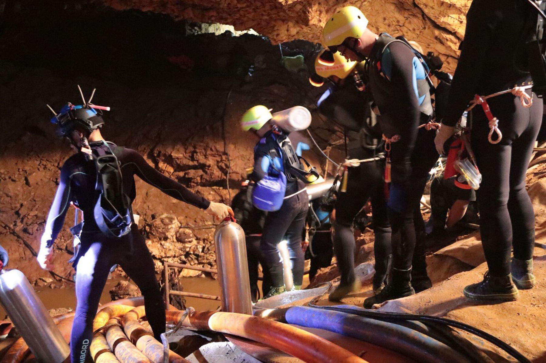 <div class='meta'><div class='origin-logo' data-origin='AP'></div><span class='caption-text' data-credit='Thai Navy via AP'>Thai rescue teams walk inside cave complex where 12 boys and their soccer coach went missing in Mae Sai, Chiang Rai province, northern Thailand.</span></div>