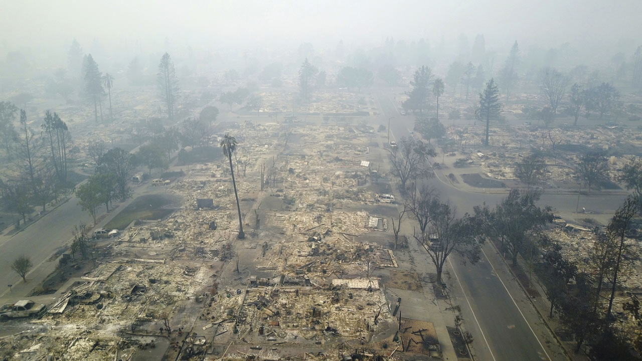 This aerial image shows a neighborhood that was destroyed by a wildfire in Santa Rosa, Calif., Tuesday, Oct. 10, 2017.