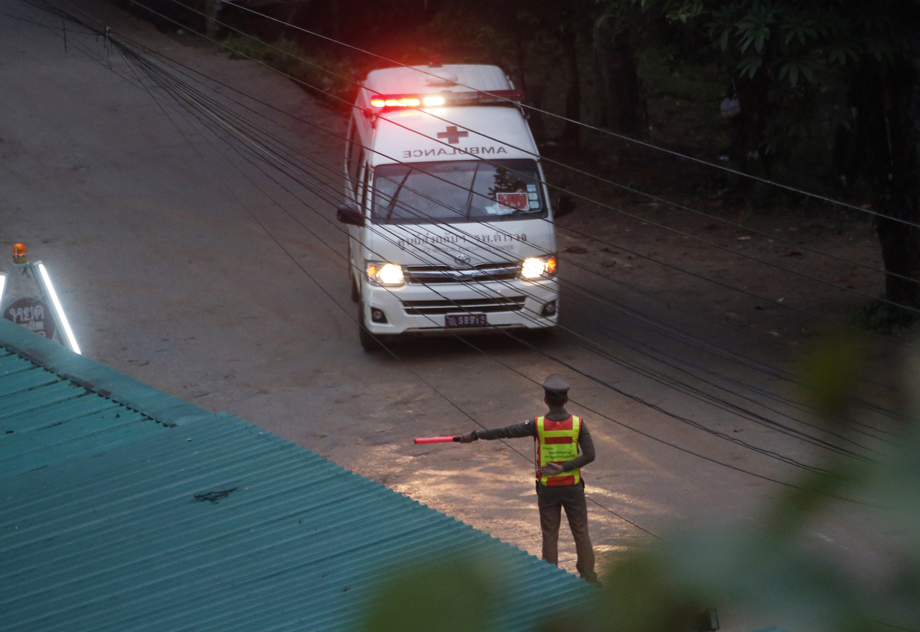 "<div class=""meta image-caption""><div class=""origin-logo origin-image ap""><span>AP</span></div><span class=""caption-text"">Two ambulances are seen leaving the cave in northern Thailand hours after operations began to rescue trapped youth soccer players. (AP Photo/Sakchai Lalit)</span></div>"