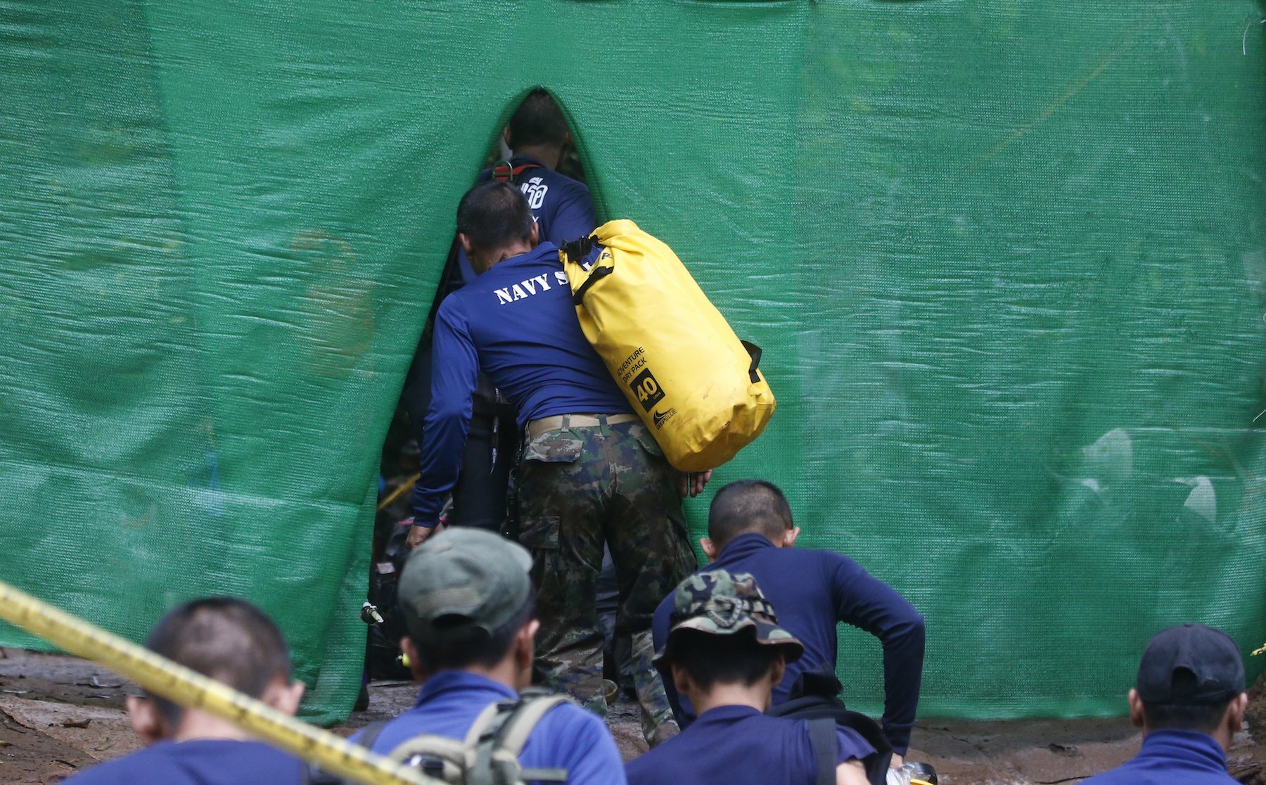 <div class='meta'><div class='origin-logo' data-origin='AP'></div><span class='caption-text' data-credit='AP Photo/Sakchai Lalit'>Rescuers arrive near the cave where 12 boys and their soccer coach have been trapped since June 23, in Mae Sai, Chiang Rai province, in northern Thailand Sunday, July 8, 2018.</span></div>