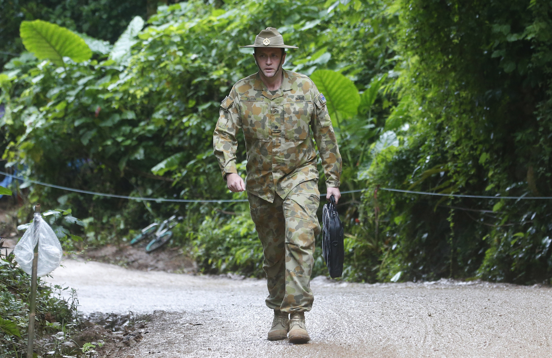 "<div class=""meta image-caption""><div class=""origin-logo origin-image ap""><span>AP</span></div><span class=""caption-text"">Australian Federal Police and Defense Force personnel arrive near a cave where 12 boys and their soccer coach have been trapped since June 23,. (AP Photo/Sakchai Lalit)</span></div>"