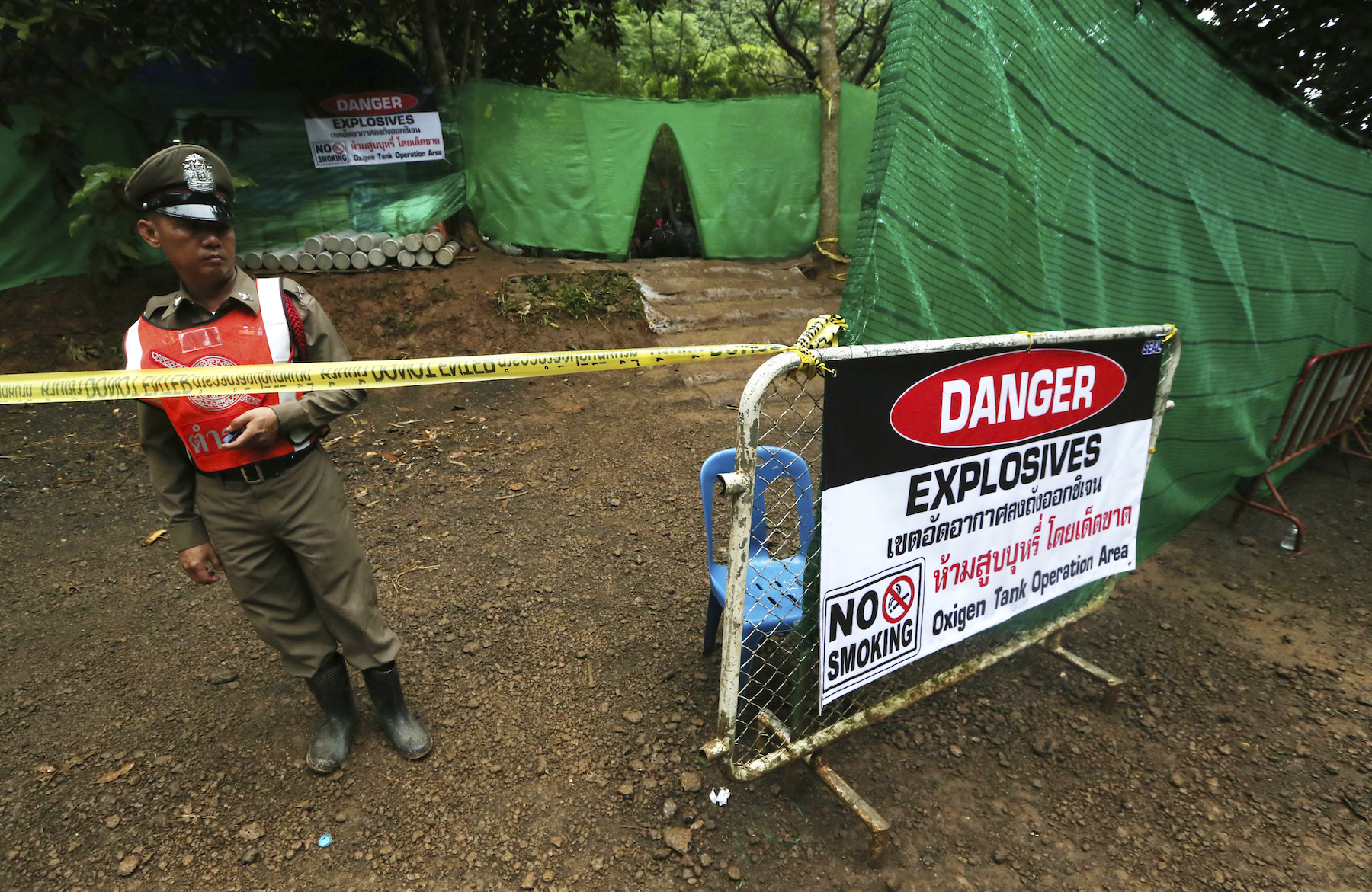 "<div class=""meta image-caption""><div class=""origin-logo origin-image ap""><span>AP</span></div><span class=""caption-text"">Thai police stand guard near a cave where 12 boys and their soccer coach have been trapped since June 23, in Mae Sai, Chiang Rai province, in northern Thailand. (AP Photo/Sakchai Lalit)</span></div>"