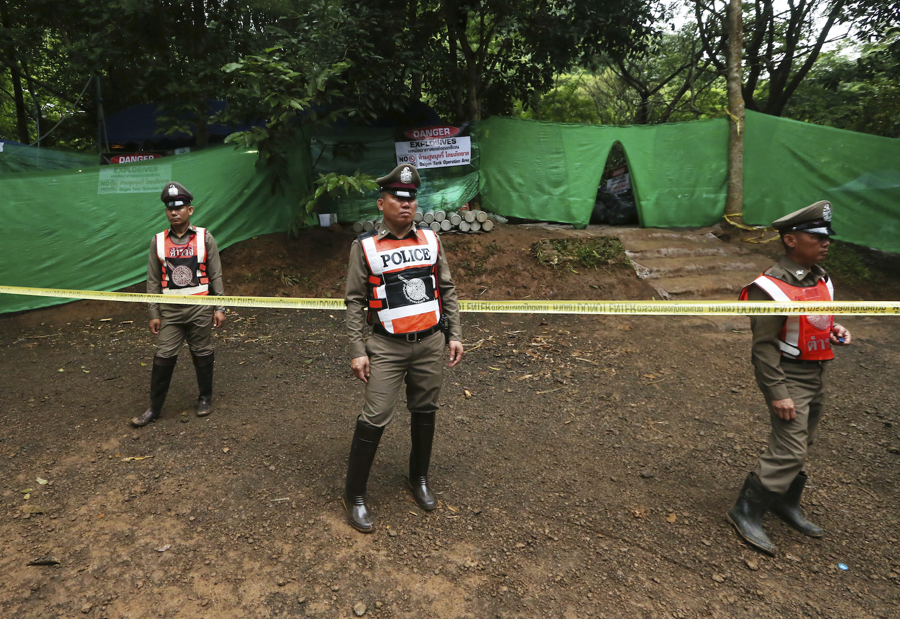<div class='meta'><div class='origin-logo' data-origin='AP'></div><span class='caption-text' data-credit='AP Photo/Sakchai Lalit'>Thai policemen stand guard near a cave where 12 boys and their soccer coach have been trapped since June 23, in Mae Sai, Chiang Rai province.</span></div>
