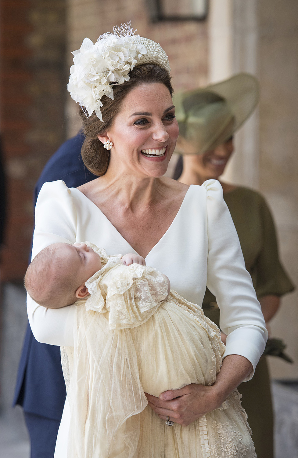<div class='meta'><div class='origin-logo' data-origin='none'></div><span class='caption-text' data-credit='Dominic Lipinski/Pool Photo via AP'>Kate, Duchess of Cambridge carries Prince Louis as they arrive for his christening service at the Chapel Royal, St James's Palace, London, Monday, July 9, 2018.</span></div>