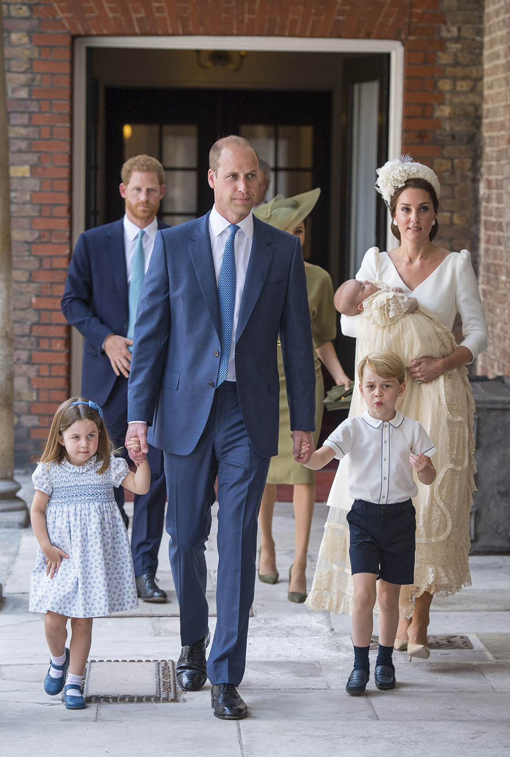 <div class='meta'><div class='origin-logo' data-origin='none'></div><span class='caption-text' data-credit='Dominic Lipinski/Pool Photo via AP'>Princess Charlotte and Prince George hold the hands of their father Prince William while Kate, Duchess of Cambridge holds Prince Louis as they arrive for his christening service.</span></div>