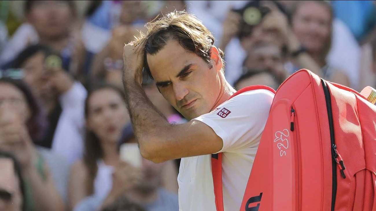 Switzerland's Roger Federer prepares to leave the court after losing his men's quarterfinals match against Kevin Anderson of South Africa.