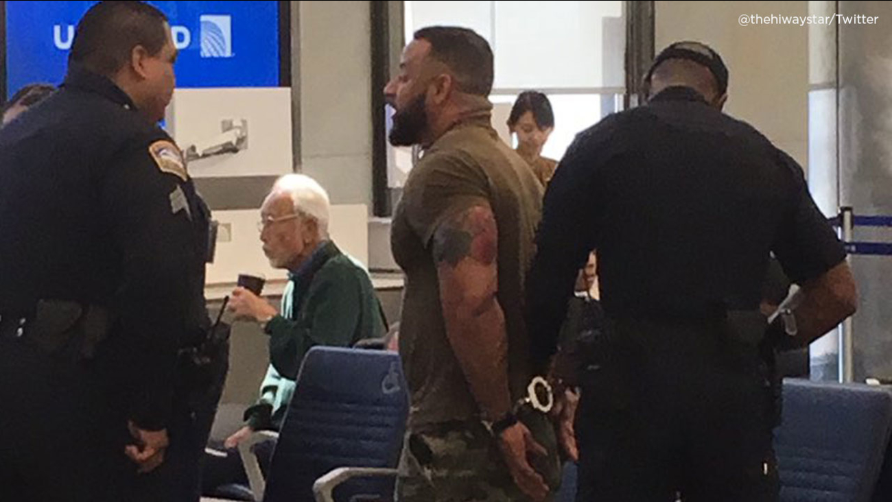 A man is handcuffed at Los Angeles International Airport for allegedly trespassing after he arrived late to his scheduled flight on Thursday, July 12, 2018.