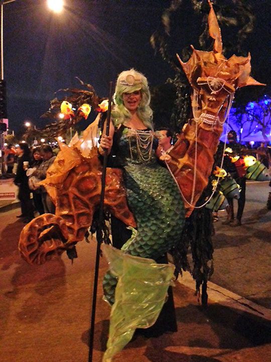 <div class='meta'><div class='origin-logo' data-origin='none'></div><span class='caption-text' data-credit=''>A reveler shows her Halloween spirit at the West Hollywood Carnaval on Friday, Oct. 31, 2014.</span></div>