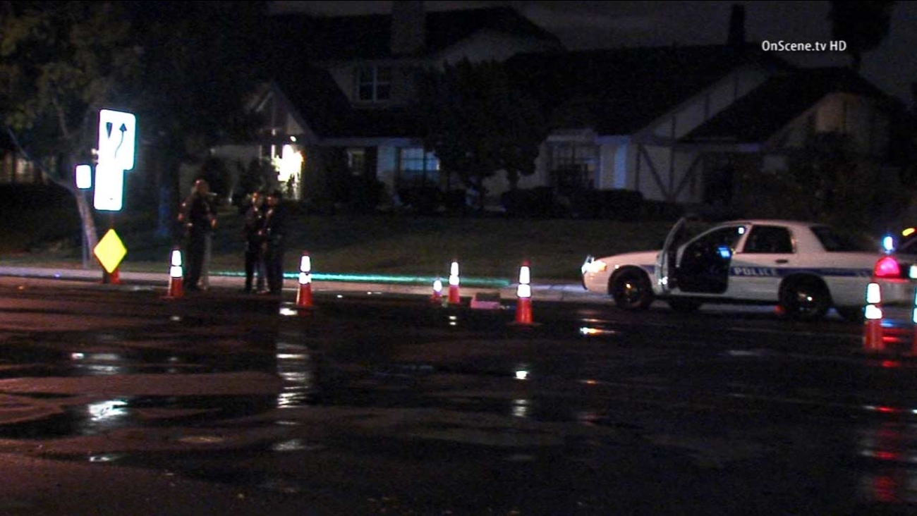 Law enforcement officials are shown at the scene of a fatal crash in Irvine on Friday, Oct. 11, 2014.