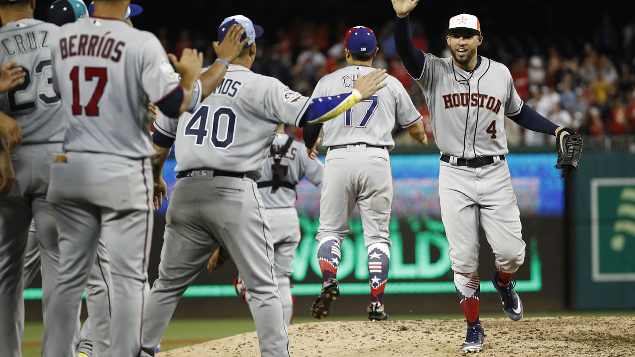 Houston Astros George Springer celebrates with his teammates at the end of the MLB All-star Game, Wednesday, July 18, 2018 in Washington. The American League won 8-6.