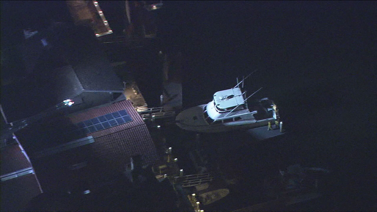 Authorities surround the harbor in Huntington Beach after an accident left one person in critical condition.