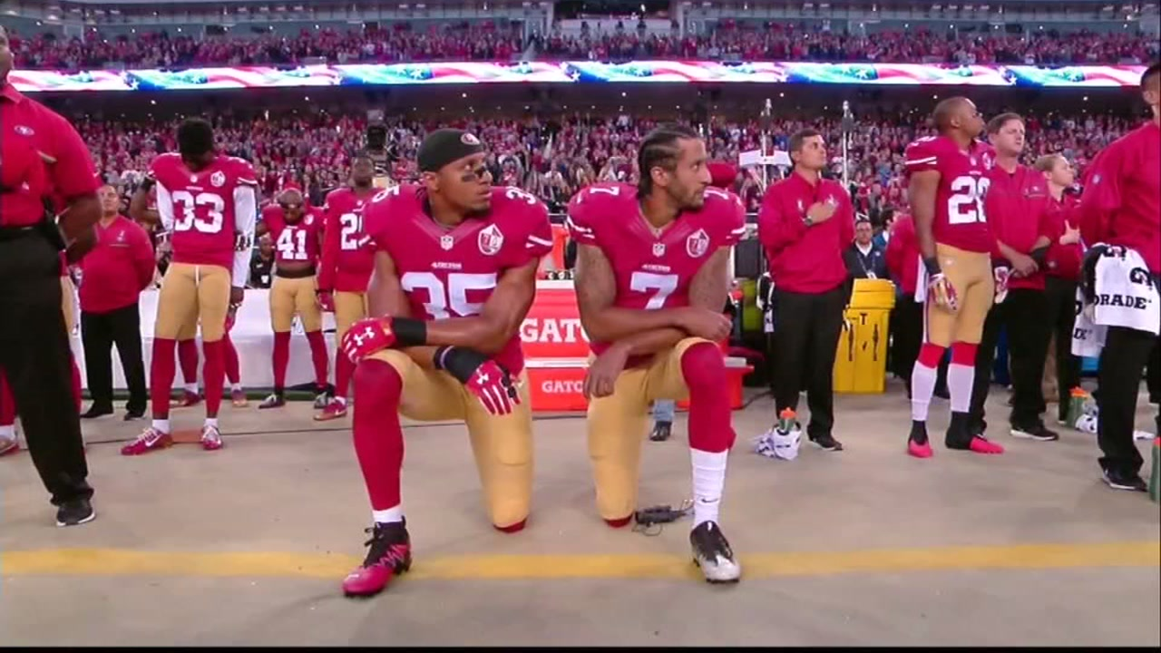 Colin Kaepernick and a teammate kneel in this undated image from a San Francisco 49ers game.