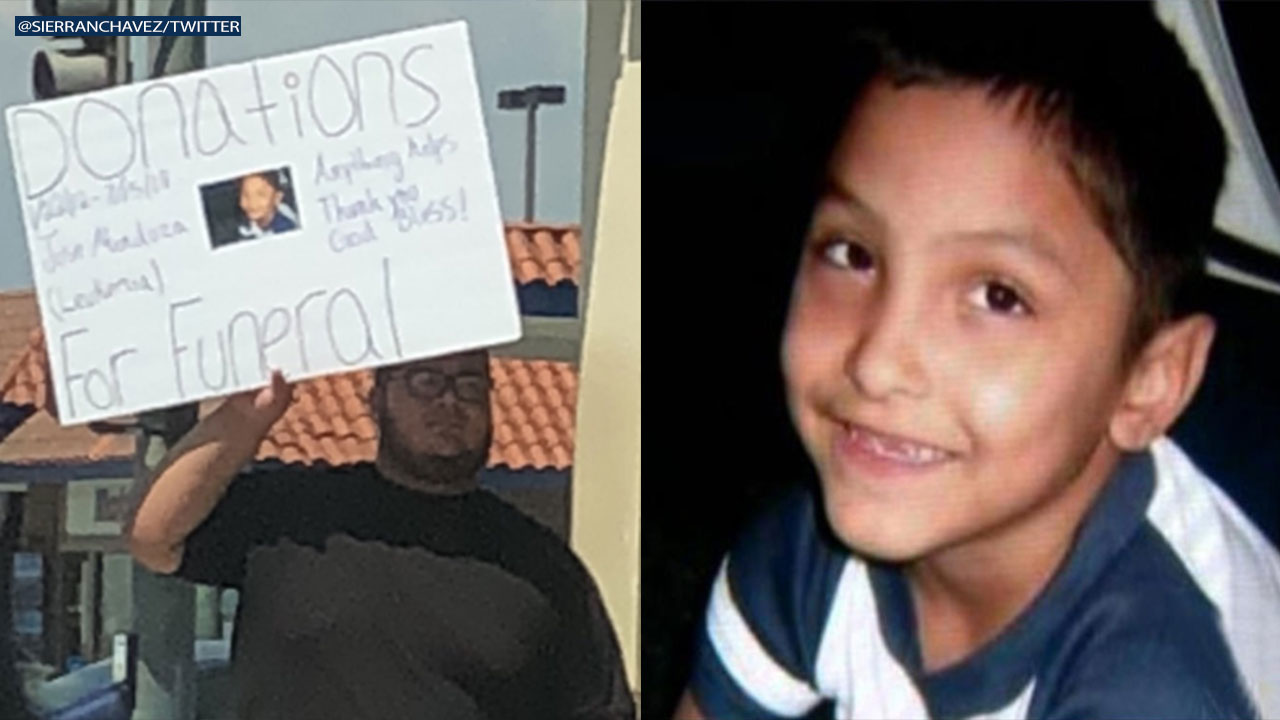 The scammers at the corner of Hacienda Boulevard and Amar Road held up a sign picturing Gabriel Fernandez, a Palmdale boy who was murdered by his mother and her boyfriend in 2013.