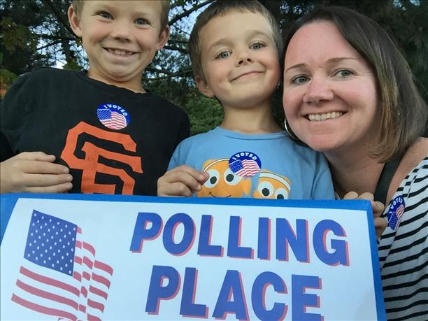 """<div class=""""meta image-caption""""><div class=""""origin-logo origin-image """"><span></span></div><span class=""""caption-text"""">""""Teaching my #futurevoters the importance of voting!"""" Photo submitted via uReport.</span></div>"""