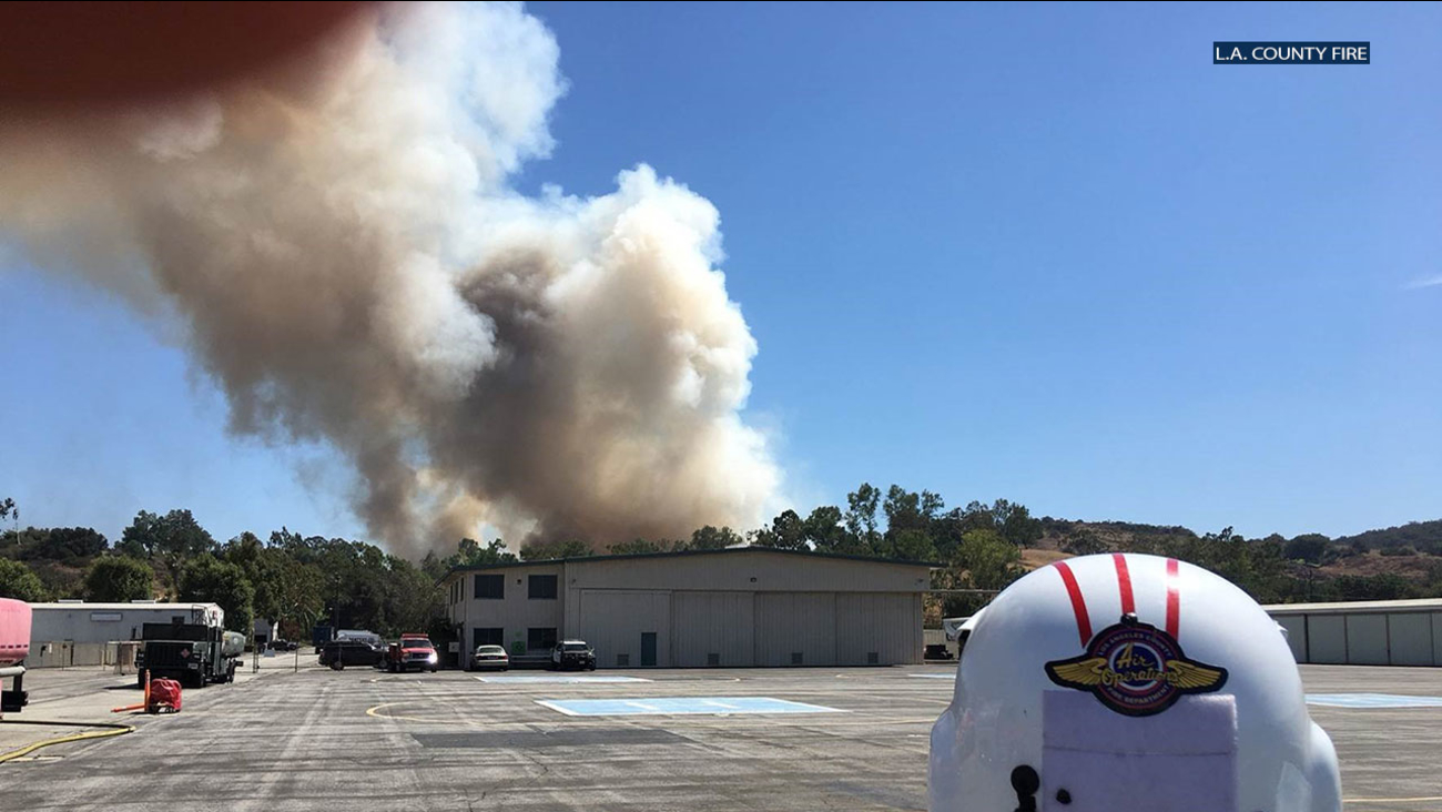 The fire prompted evacuations as it moved uphill after originating along North Fairplex Drive shortly before 3 p.m., according to L.A. County fire officialS.