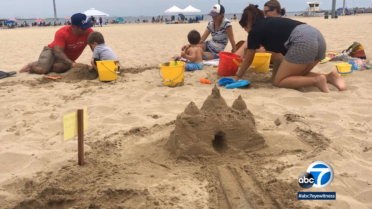 Dozens of families grabbed buckets and shovels to build sand sculptures for the 7th annual Cabrillo Marine Aquarium Family Sandcastle Day in San Pedro.