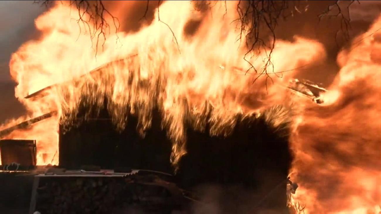 A home burns near Redding, Calif. on Sunday, July 29, 2018.