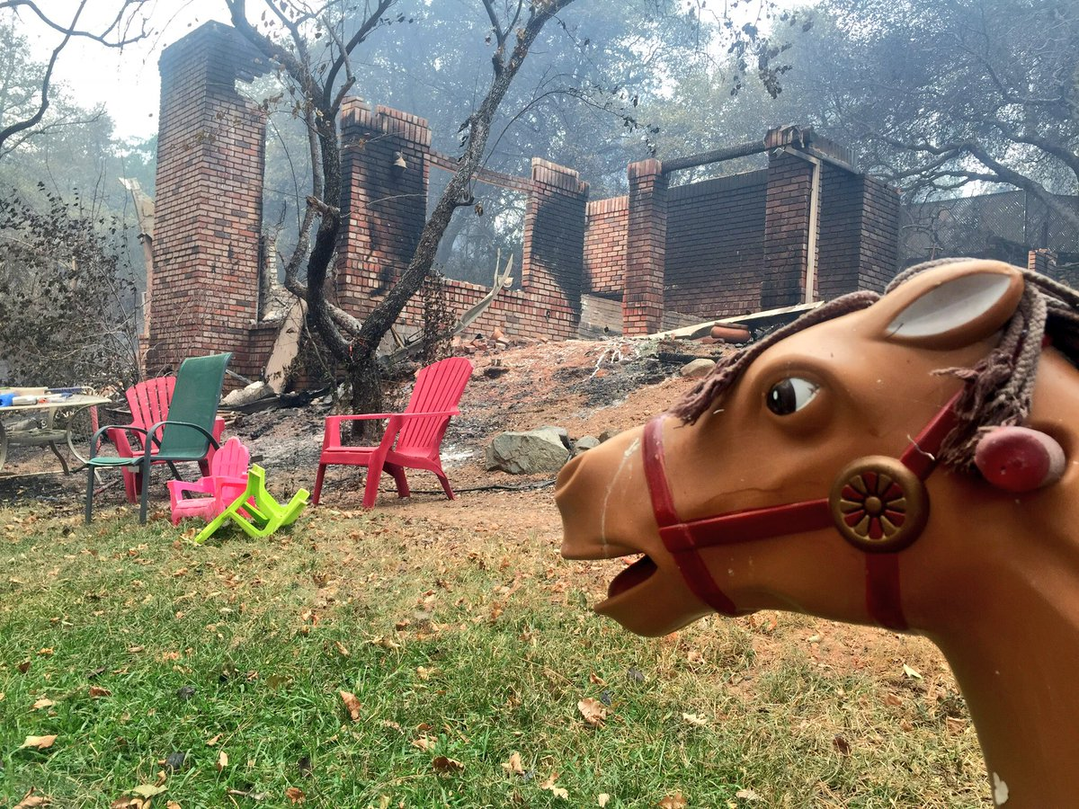 <div class='meta'><div class='origin-logo' data-origin='none'></div><span class='caption-text' data-credit='KGO-TV'>A child's rocking horse and some lawn chairs are all that's left of a home in west Redding, Calif. on Saturday, July 28, 2018.</span></div>