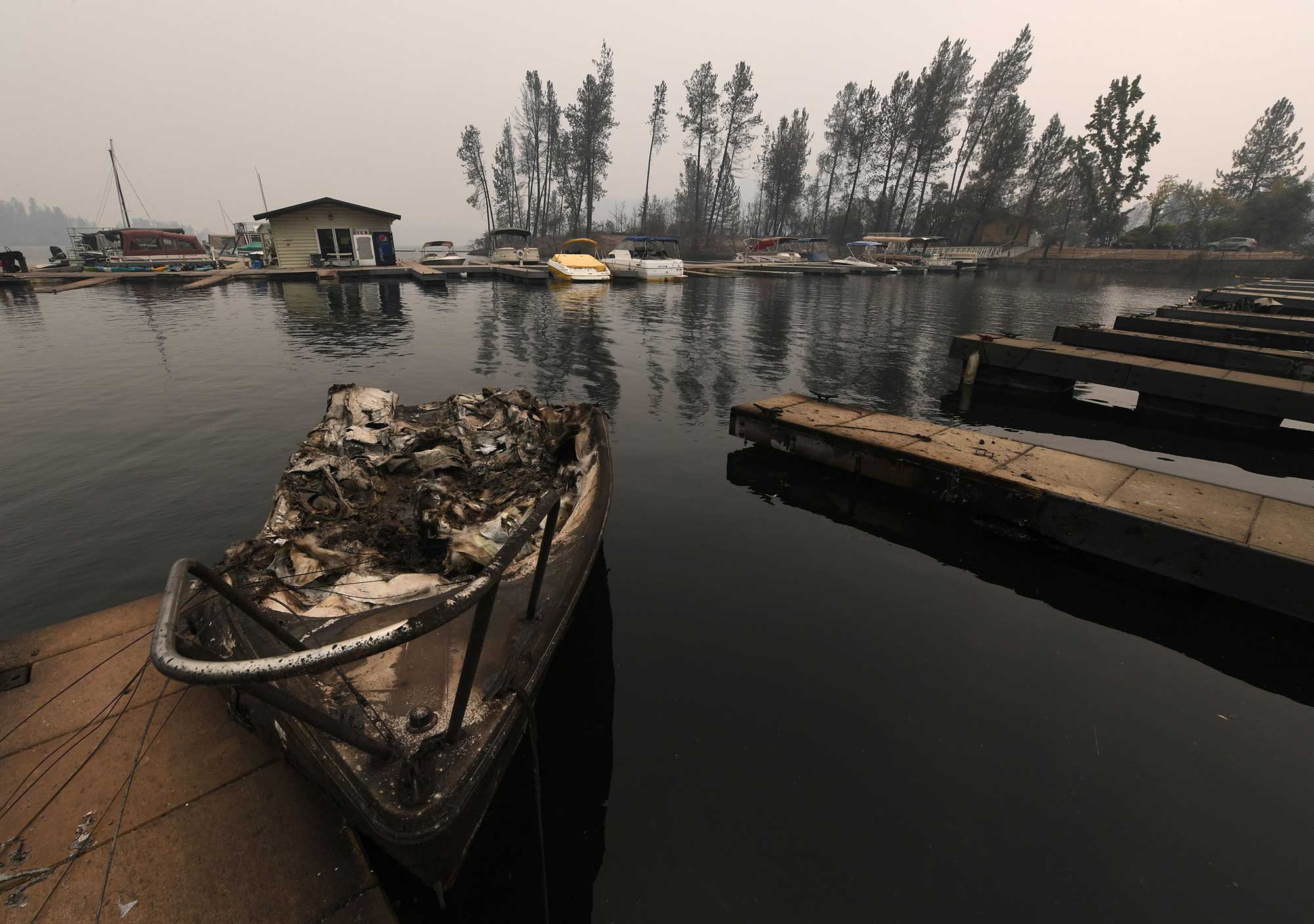 <div class='meta'><div class='origin-logo' data-origin='none'></div><span class='caption-text' data-credit='MARK RALSTON/AFP/Getty Images'>A burnt out boat sits at a marina on Whiskeytown Lake after damage from the Carr fire near Redding, California, on July 30, 2018.</span></div>