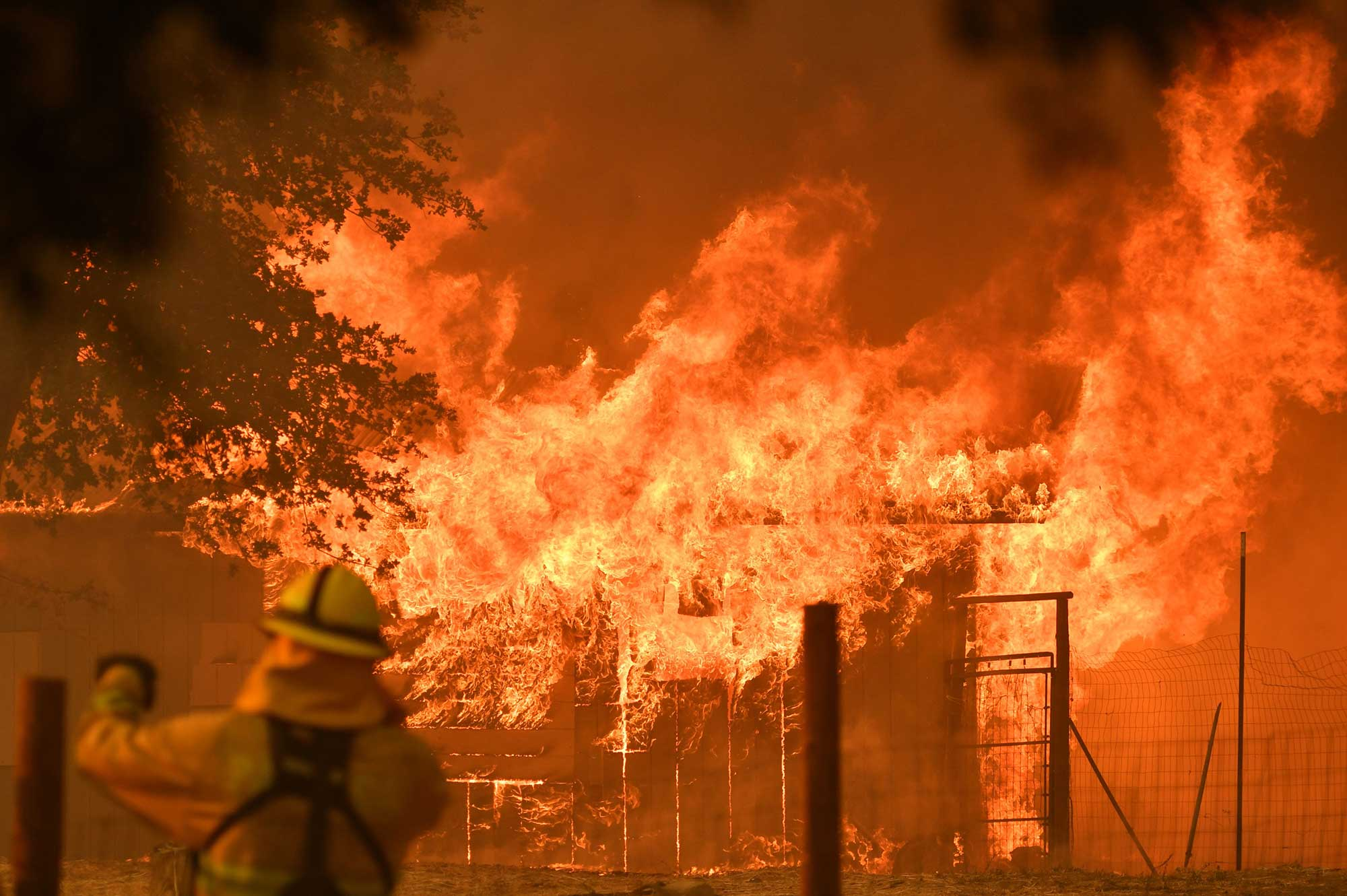 <div class='meta'><div class='origin-logo' data-origin='none'></div><span class='caption-text' data-credit='JOSH EDELSON/AFP/Getty Images'>A firefighter watches as a building burns during the Mendocino Complex fire in Lakeport, California, on July 30, 2018.</span></div>