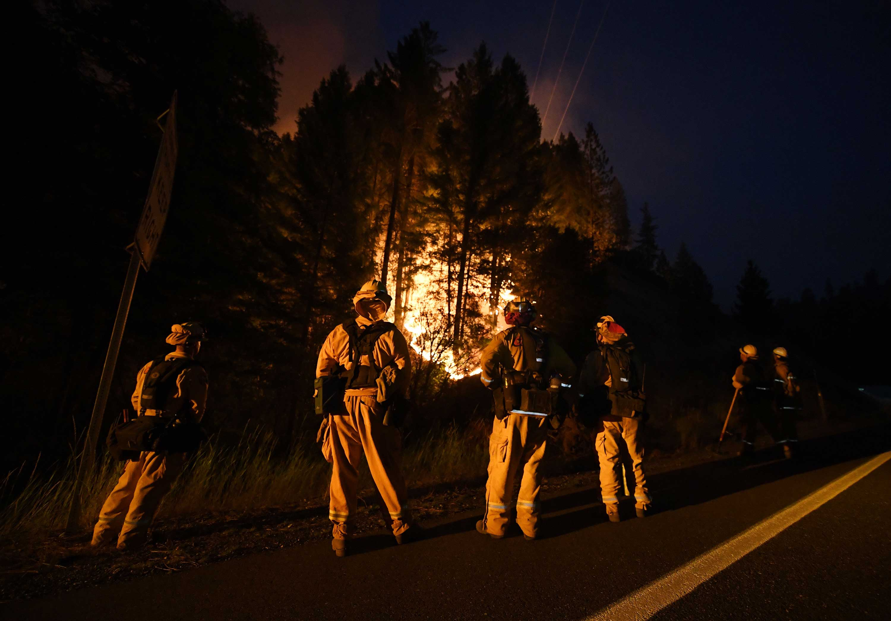 "<div class=""meta image-caption""><div class=""origin-logo origin-image none""><span>none</span></div><span class=""caption-text"">Firefighters keep watch at a containment line as the Carr fire continues to spreads towards the town of Douglas City near Redding, California, on July 30, 2018. (MARK RALSTON/AFP/Getty Images)</span></div>"