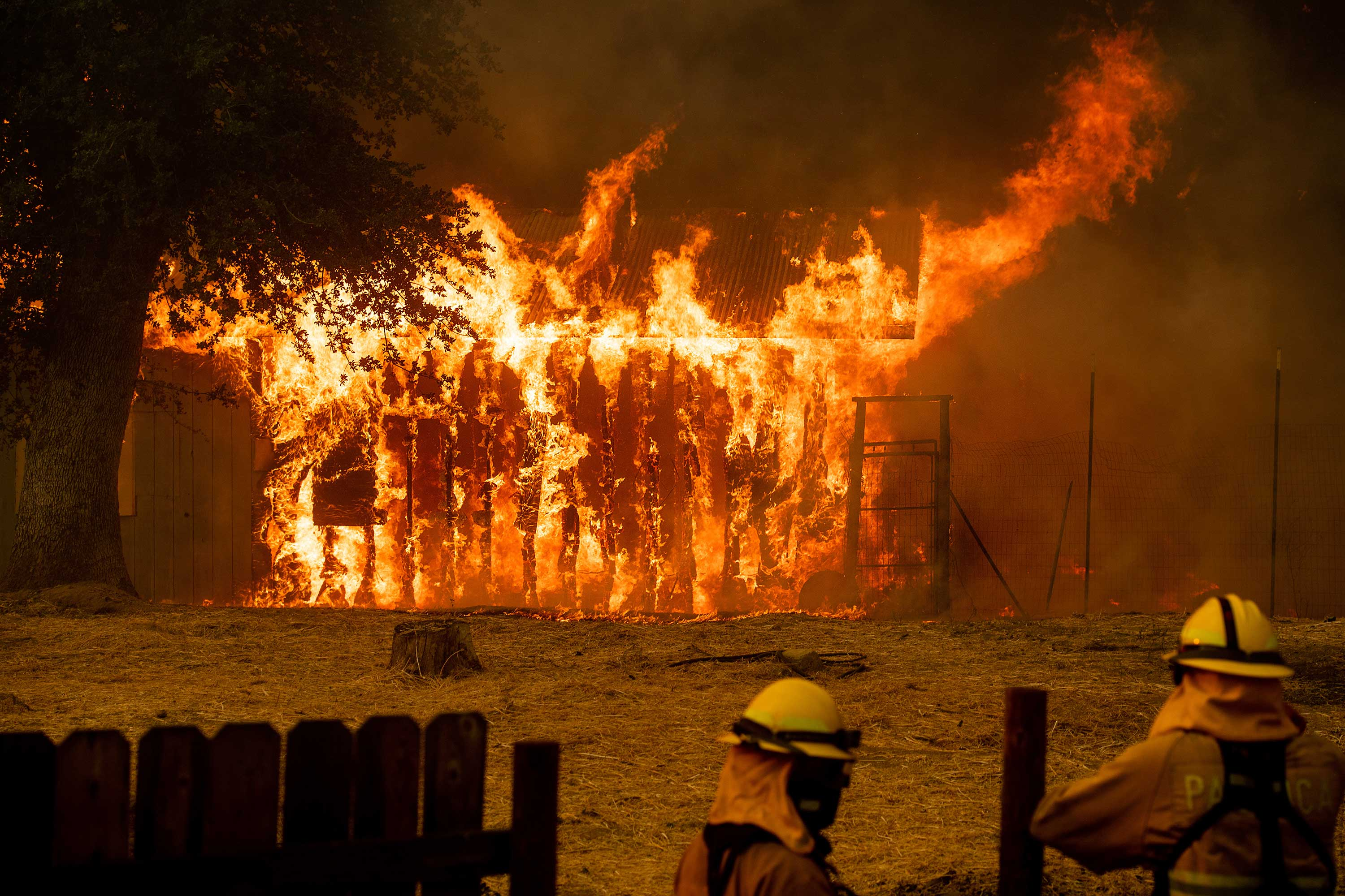 "<div class=""meta image-caption""><div class=""origin-logo origin-image none""><span>none</span></div><span class=""caption-text"">Firefighters monitor a burning outbuilding to ensure flames don't spread as the River Fire burns in Lakeport, Calif., on Monday, July 30. (Noah Berger/AP Photo)</span></div>"