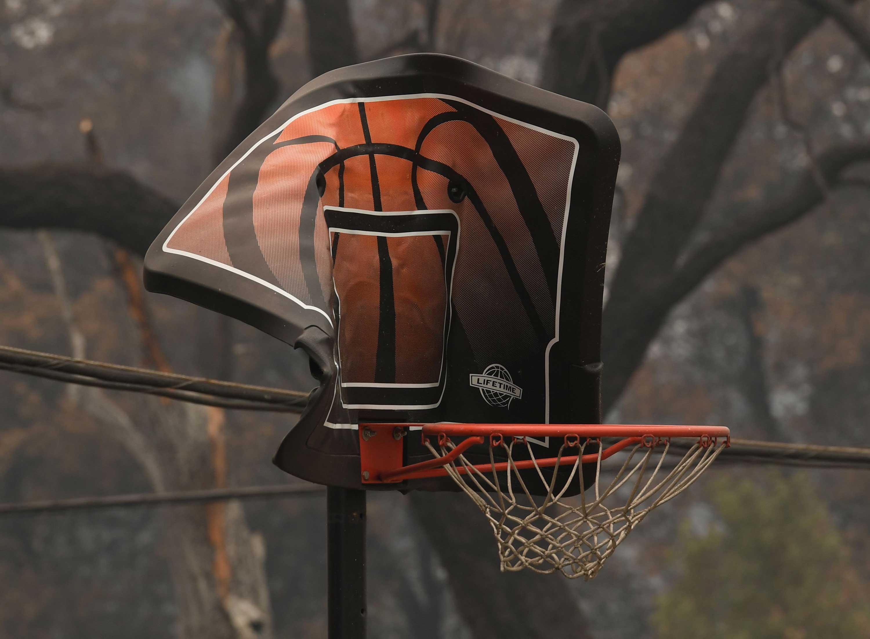 "<div class=""meta image-caption""><div class=""origin-logo origin-image none""><span>none</span></div><span class=""caption-text"">A fire damaged basketball hoop in the Keswick neighborhood of Redding, as the Carr fire continues to spreads towards the town of Douglas City near Redding, California on July 31. (MARK RALSTON/AFP/Getty Images)</span></div>"