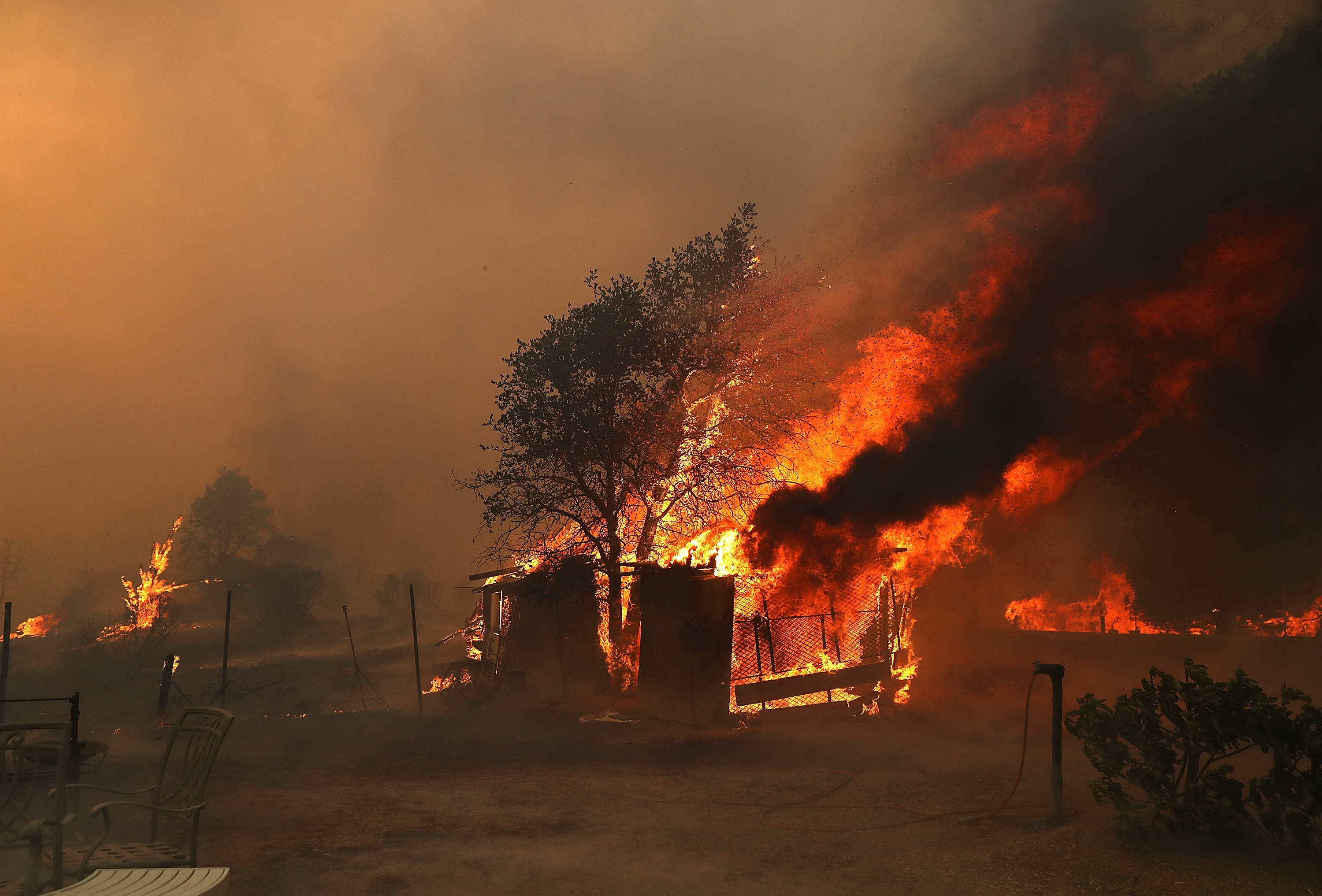"<div class=""meta image-caption""><div class=""origin-logo origin-image none""><span>none</span></div><span class=""caption-text"">A structure burns as the River Fire burns through the area on July 31, 2018 in Lakeport, California. (Justin Sullivan/Getty Images)</span></div>"