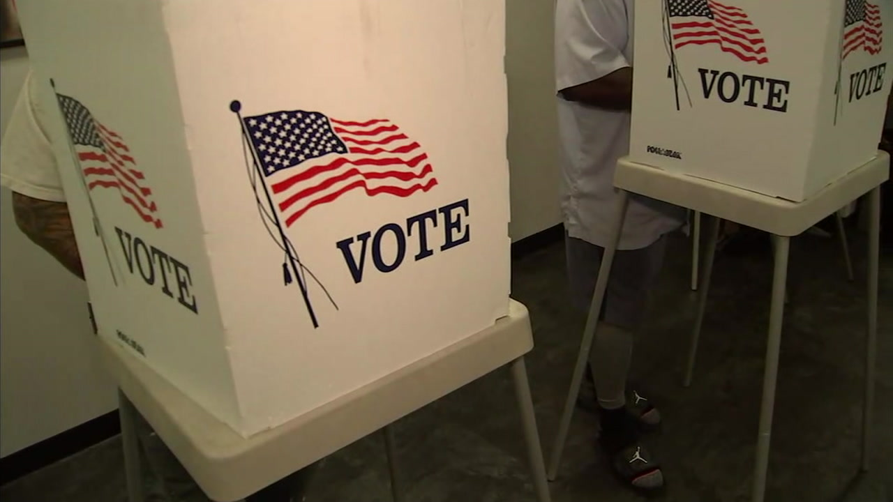 A voting booth is shown in an undated photo from a Los Angeles County polling place.