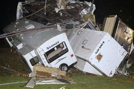 """<div class=""""meta image-caption""""><div class=""""origin-logo origin-image """"><span></span></div><span class=""""caption-text"""">Travel trailers and motor homes are piled on top of each other at Mayflower RV in Mayflower, Ark., Sunday, April 27, 2014.A powerful storm system rumbled through the central and southern United States on Sunday, spawning tornadoes. (AP Photo/Danny Johnston)</span></div>"""