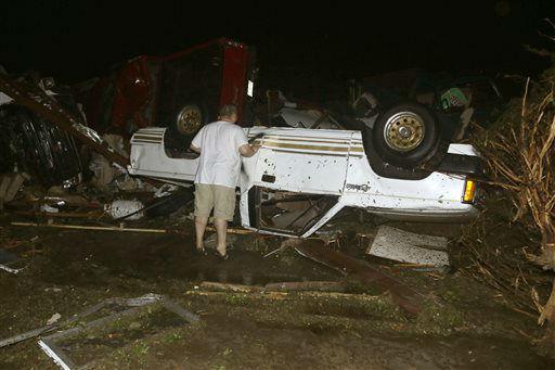 "<div class=""meta image-caption""><div class=""origin-logo origin-image ""><span></span></div><span class=""caption-text"">John Ward, an automobile and RV dealer, looks an tornado damage to one of his trucks in Mayflower, Ark., Sunday, April 27, 2014. A tornado struck the dealer's on lot Sunday. (AP Photo/Danny Johnston)</span></div>"