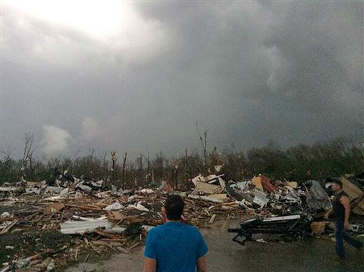 """<div class=""""meta image-caption""""><div class=""""origin-logo origin-image """"><span></span></div><span class=""""caption-text"""">This photo provided by James Bryant shows tornado damage, Sunday, April 27, 2014 in Mayflower, Ark. A powerful storm system rumbled through the central and southern United States on Sunday, spawning several tornadoes, including one that killed two people in a small northeastern Oklahoma city and another that carved a path of destruction through several northern suburbs of Little Rock, Ark. (AP Photo/Courtesy of James Bryant)</span></div>"""