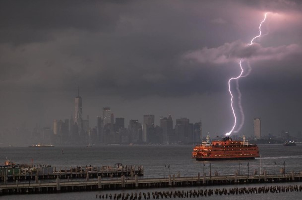 <div class='meta'><div class='origin-logo' data-origin='none'></div><span class='caption-text' data-credit='portraitsbyvalentino via Instagram'>Viewers posted dramatic images on social media of lightning strikes in and around New York City on August 7, 2018.  In this image, lightning appears to hit the Staten Island Ferry.</span></div>