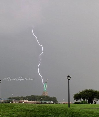 <div class='meta'><div class='origin-logo' data-origin='none'></div><span class='caption-text' data-credit='Neeti Kumthekar/Instagram'>Viewers posted dramatic images on social media of lightning strikes in and around New York City on August 7, 2018.</span></div>