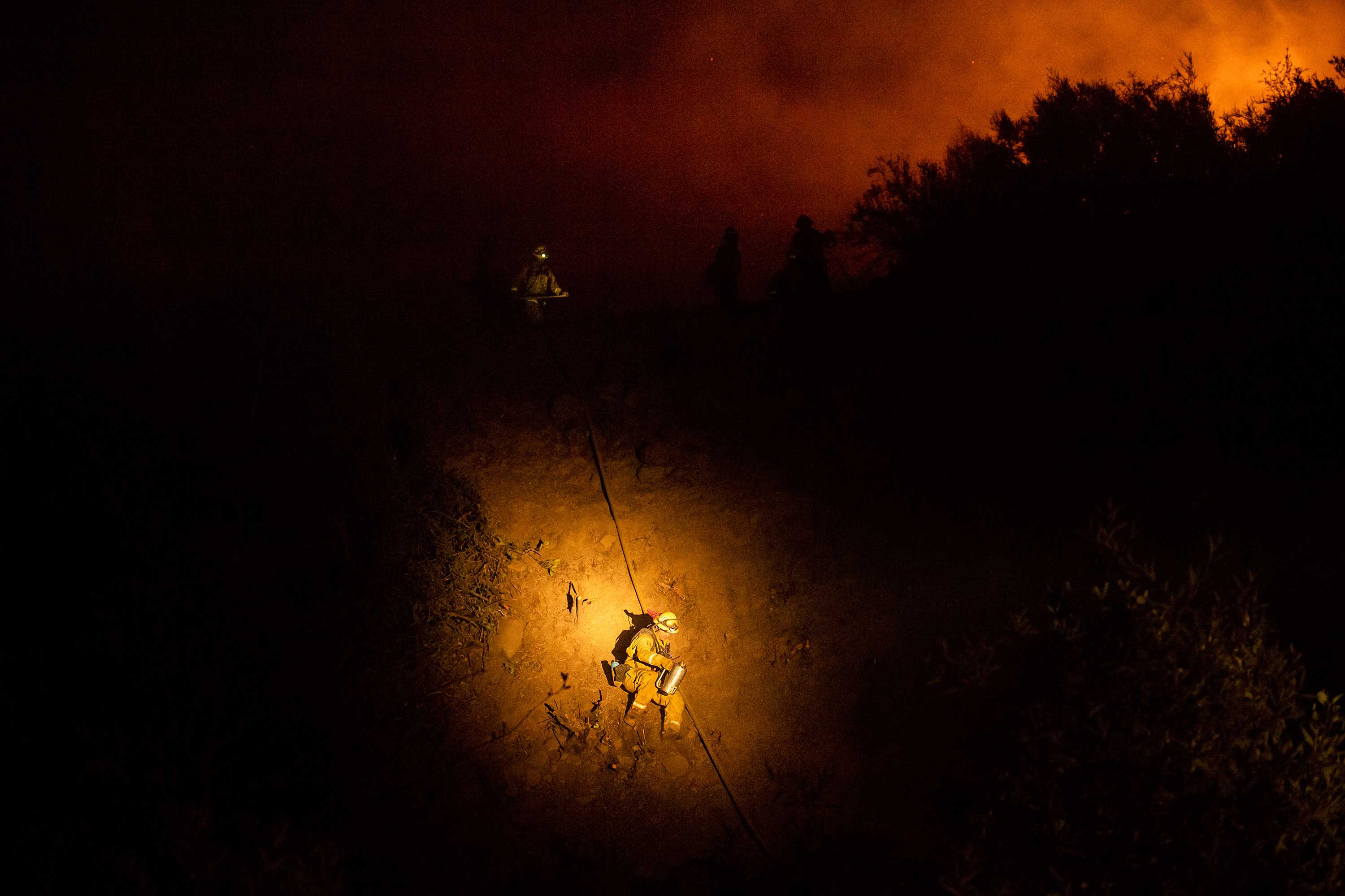 <div class='meta'><div class='origin-logo' data-origin='none'></div><span class='caption-text' data-credit='Noah Berger/AP Photo'>Firefighter Brandon Esquer makes his way down a hillside while battling the Ranch Fire, part of the Mendocino Complex Fire, on Tuesday, Aug. 7, 2018, near Ladoga, Calif.</span></div>