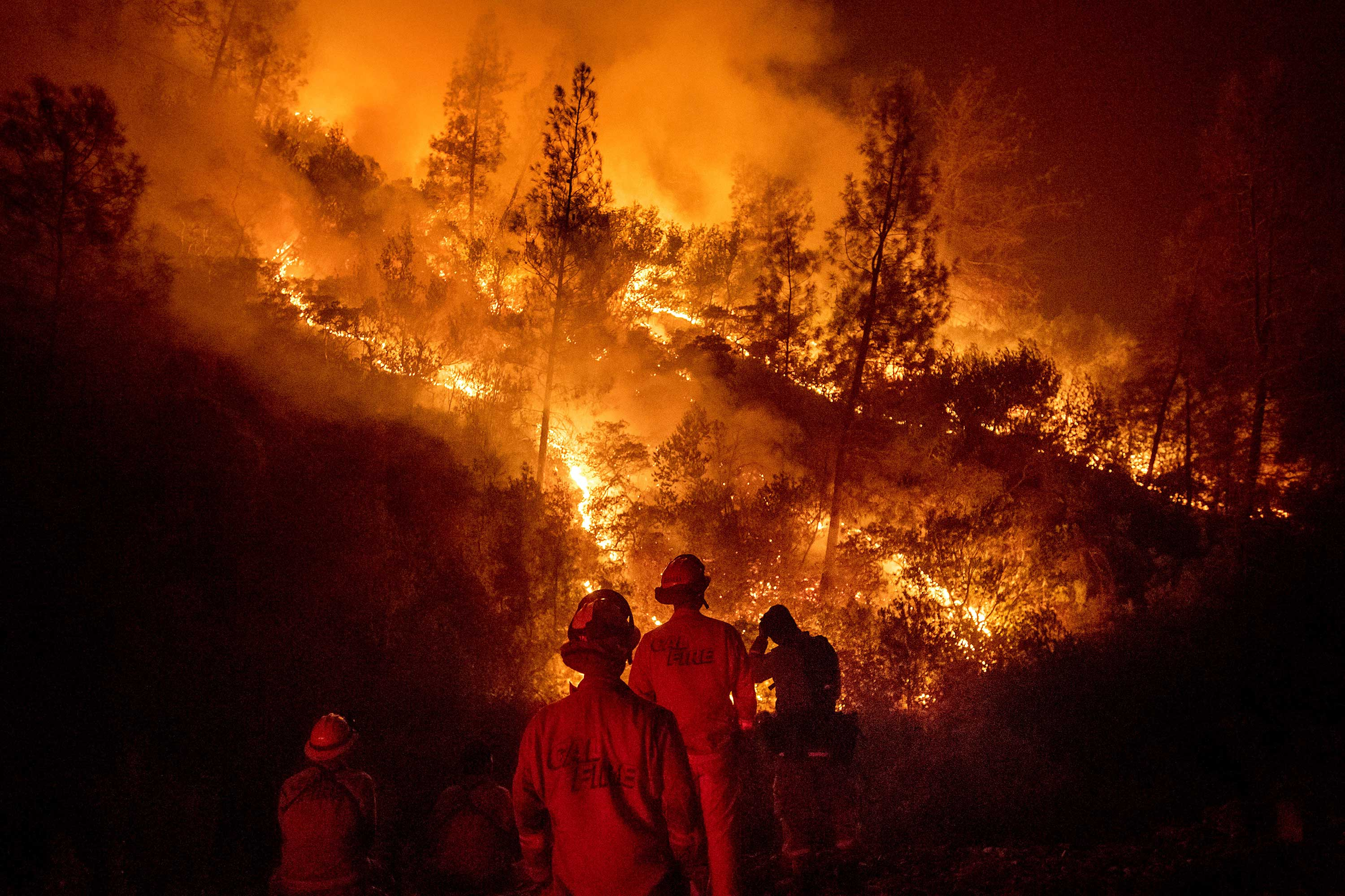 <div class='meta'><div class='origin-logo' data-origin='none'></div><span class='caption-text' data-credit='Noah Berger/AP Photo'>Firefighters monitor a backfire while battling the Ranch Fire, part of the Mendocino Complex Fire, on Tuesday, Aug. 7, 2018, near Ladoga, Calif.</span></div>