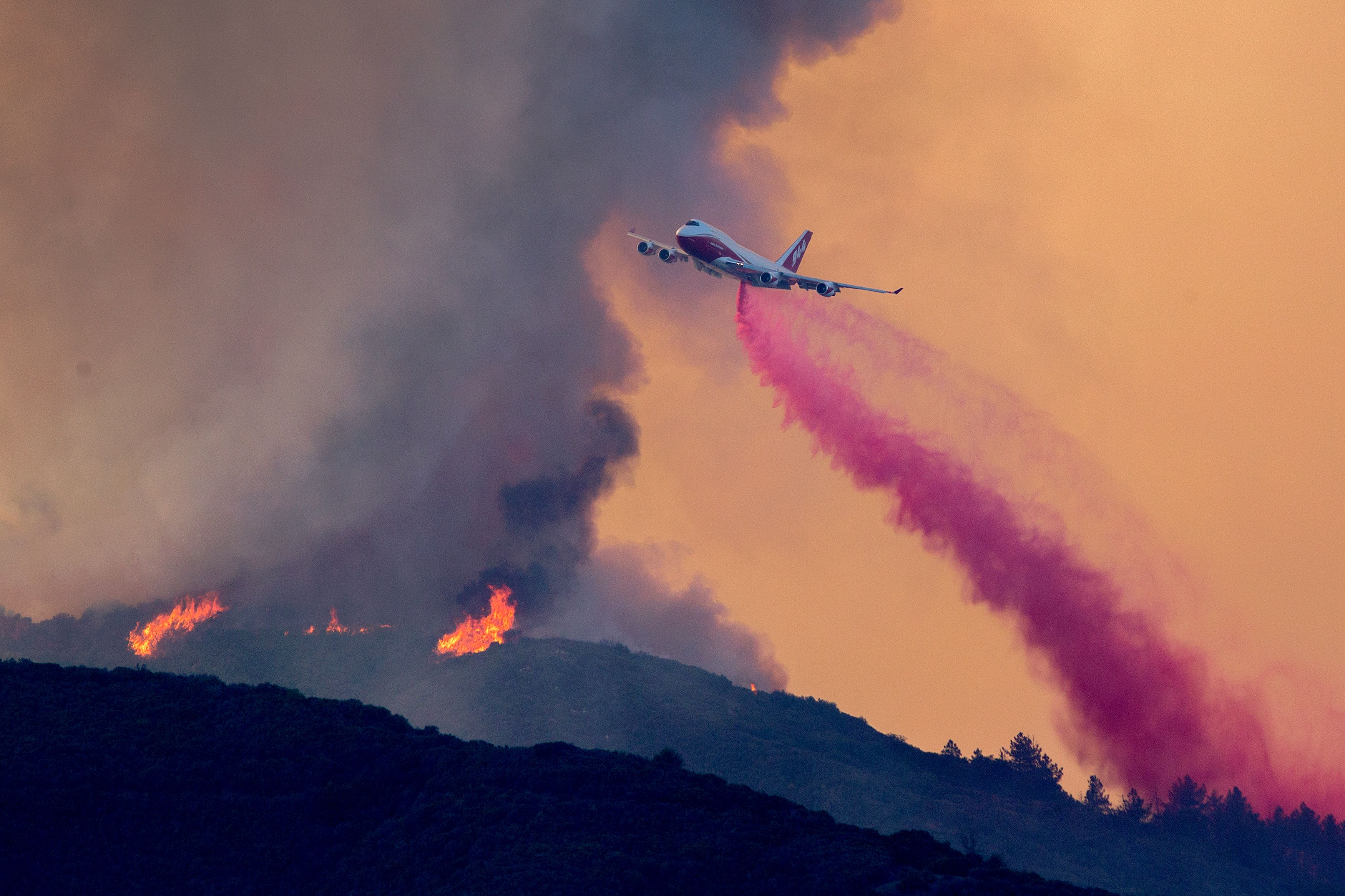 <div class='meta'><div class='origin-logo' data-origin='none'></div><span class='caption-text' data-credit='DAVID MCNEW/AFP/Getty Images'>A 747 Global Supertanker jet drops fire retardant at the Holy Fire near Lake Elsinore, in Orange County, California, on August 7, 2018.</span></div>