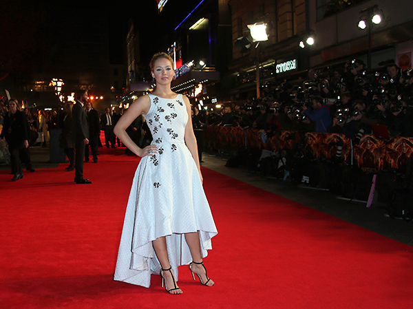 "<div class=""meta image-caption""><div class=""origin-logo origin-image ""><span></span></div><span class=""caption-text"">Jennifer Lawrence poses for photographers upon arrival to the world premiere of 'The Hunger Games: Mockingjay Part 1' in London, Monday, Nov. 10, 2014. (Joel Ryan/Invision/AP)</span></div>"