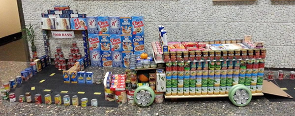 "<div class=""meta image-caption""><div class=""origin-logo origin-image ""><span></span></div><span class=""caption-text"">DRIVE OUT HUNGER: Mobile food pantry truck illustrates Alameda County's ongoing commitment to help end hunger.  This display was made from 550 pounds of food.</span></div>"