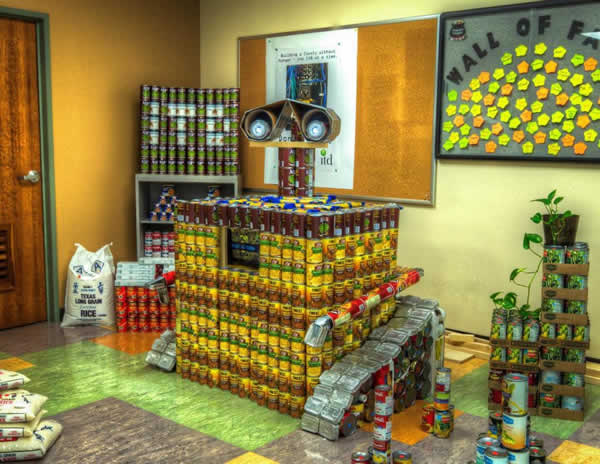 "<div class=""meta image-caption""><div class=""origin-logo origin-image ""><span></span></div><span class=""caption-text"">WALL-E: Wall-E's creativity for building structures out of cans represents a fun way in dealing with a serious issue.  Structure made from 2222.50 lbs.</span></div>"