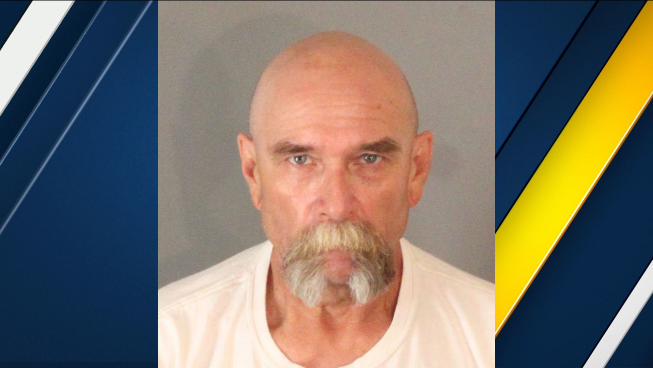 John Titow, 59, is shown in a mugshot.
