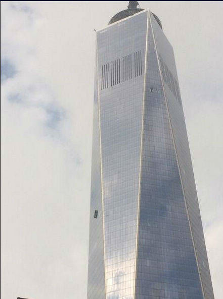 """<div class=""""meta image-caption""""><div class=""""origin-logo origin-image """"><span></span></div><span class=""""caption-text"""">Two workers became stuck on scaffolding hanging from One World Trade.  (Photo courtesy: Mike C @jerseyboyu2)</span></div>"""