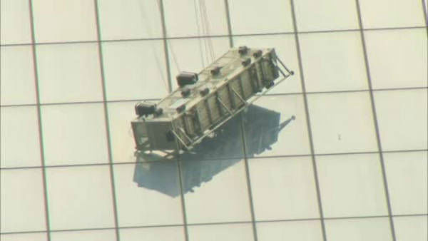 """<div class=""""meta image-caption""""><div class=""""origin-logo origin-image """"><span></span></div><span class=""""caption-text"""">Two workers became stuck on scaffolding hanging from the World Trade Center.</span></div>"""