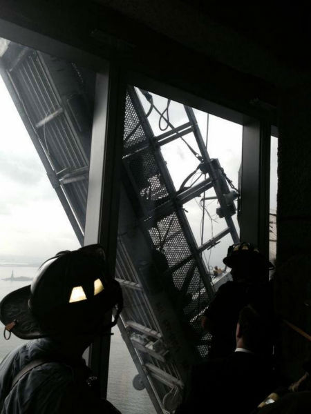"""<div class=""""meta image-caption""""><div class=""""origin-logo origin-image """"><span></span></div><span class=""""caption-text"""">Firefighters attempted to rescue the trapped workers.  (Photo courtesy: FDNY/Twitter.)</span></div>"""